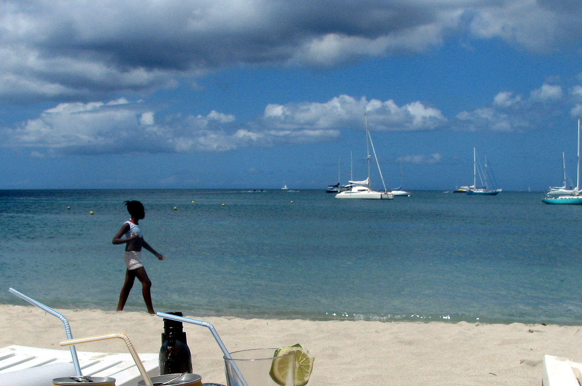 black girl walking on the tropical beach Martinique plage anse des Sables